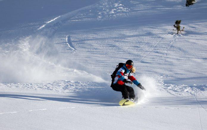 Snowboard in Deep Snow